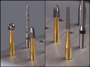 four carbide dental burs and a diamond dental bur